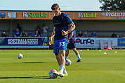 AFC Wimbledon midfielder Callum Reilly (33) warming up during the EFL Sky Bet League 1 match between AFC Wimbledon and Bristol Rovers at the Cherry Red Records Stadium, Kingston, England on 21 September 2019.