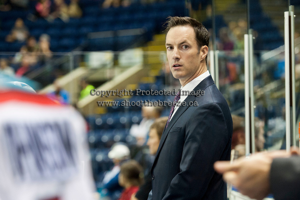 KELOWNA, CANADA - SEPTEMBER 5: Brad Ralph, head coach of the Kelowna Rockets stands on the bench during a preseason  game against the Prince George Cougars on September 5, 2015 during the first pre-season game at Prospera Place in Kelowna, British Columbia, Canada.  (Photo by Marissa Baecker/Shoot the Breeze)  *** Local Caption *** Brad Ralph;