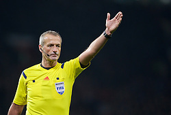 MANCHESTER, ENGLAND - Tuesday, November 18, 2014: Referee Martin Atkinson during the International Friendly match between Argentina and Portugal at Old Trafford. (Pic by David Rawcliffe/Propaganda)