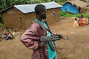 One MRC ( Congolese revolutionary Movement) child soldier stands in kambutso village in Ituri during MRC President Ngudjolo, MRC Secretary-General Mbutho additional negotiations with governmental delegation and MONUC ( UN Mission to DR Congo) to discuss practical terms for MRC's voluntary surrender, disarmament and integration. Photo by Martine PERRET16/11/2006