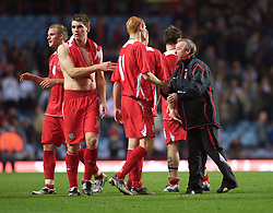 BIRMINGHAM, ENGLAND - Monday, October 13, 2008: Wales' manager Brian Flynn consoles Shaun MacDonald after his side's defeat by England during the UEFA European Under-21 Championship Play-Off 2nd Leg match at Villa Park. (Photo by Gareth Davies/Propaganda)