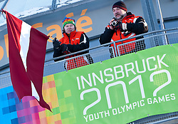 "15.01.2012, Bobbahn Igls, Innsbruck, AUT, Olympische Jugend Winterspiele, Rodeln, Herren, im Bild Lettische Fans vor dem Logo Innsbruck 2012 Youth Olympic Games // Latvian fans at the Innsbruck 2012 Youth Olympic Games logo during the Mens Luge of the Winter Youth Olympic Games at the ""Bob Track Igls"", Innsbruck, Austria on 2012/01/15, EXPA Pictures © 2012, PhotoCredit: EXPA/ Juergen Feichter"