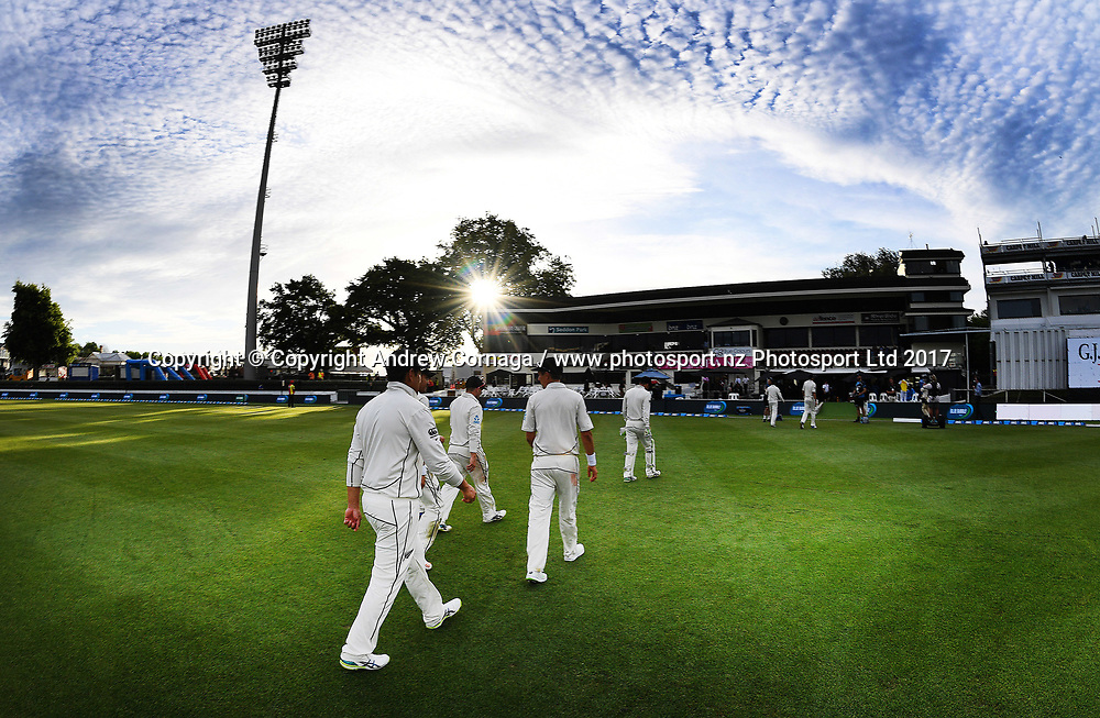 Ross Taylor and team mates leave the field at the end of extended play on day 2. New Zealand Black Caps v West Indies. 2nd test match of the ANZ International Cricket Season 2017/18 season. Seddon Park, Hamilton, New Zealand. Sunday 10 December 2017. © Copyright photo: Andrew Cornaga / www.photosport.nz