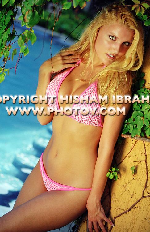 Sexy Blonde woman in bikini, Cabo San Lucas, Mexico.