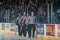 KELOWNA, CANADA - MARCH 7: Linesmen Ward Pateman and Dustin Minty with Referees Reid Anderson and Jason Cramer line up for the national anthem between the Kelowna Rockets and the Spokane Chiefs on March 7, 2015 at Prospera Place in Kelowna, British Columbia, Canada.  (Photo by Marissa Baecker/Shoot the Breeze)  *** Local Caption *** Ward Pateman; Dustin Minty ; Reid Anderson; Jason Cramer;