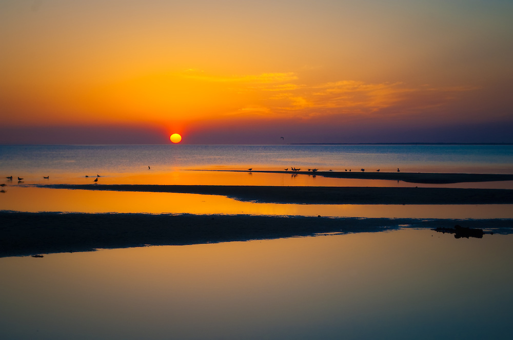 Another day ends beautifully with a dazzling sunset over Apalachicola Bay on the Florida Panhandle.