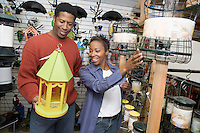 Couple Choosing a Birdhouse