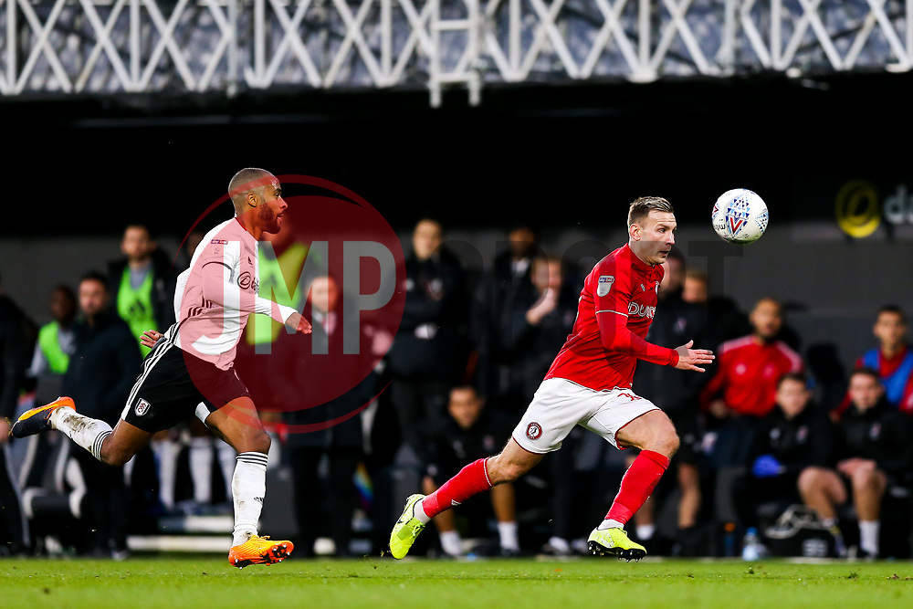 Andi Weimann of Bristol City is challenged by Denis Odoi of Fulham - Rogan/JMP - 07/12/2019 - Craven Cottage - London, England - Fulham v Bristol City - Sky Bet Championship.