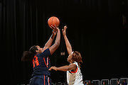 February 20, 2014: Shakeya Leary #34 of Syracuse shoots over Jassany Williams #21 of Miami during the NCAA basketball game between the Miami Hurricanes and the Syracuse Orange at the Bank United Center in Coral Gables, FL. The Orange defeated the Hurricanes 69-48.