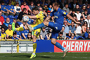 AFC Wimbledon striker James Hanson (18)battles for possession with Bristol Rovers midfielder Alex Rodman (33) during the EFL Sky Bet League 1 match between AFC Wimbledon and Bristol Rovers at the Cherry Red Records Stadium, Kingston, England on 19 April 2019.