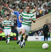 Celtic's Andreas Hinkel goes ways from Rangers' Nacho Novo during the League Cup final between Rangers and Celtic at Hampden Park -<br /> David Young Universal News And Sport