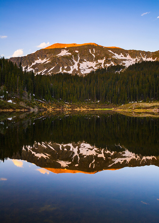 Mountain reflectiing in Williams Lake. Wheeler Peak Wilderness near Taos, New Mexico.