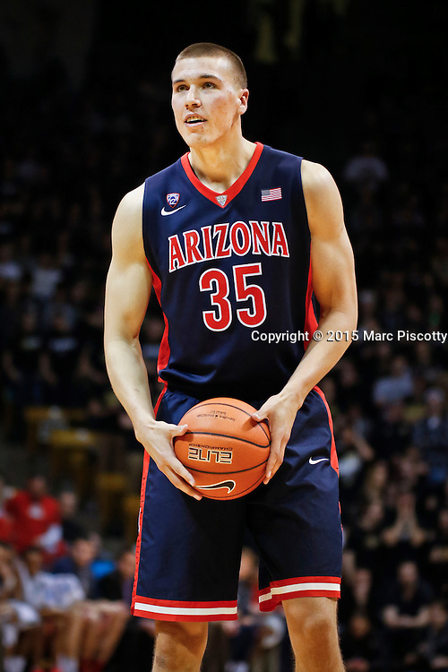 SHOT 2/26/15 8:28:40 PM - Arizona's Kaleb Tarczewski #35 lines up to shoot a free throw against Colorado during their regular season Pac-12 basketball game at the Coors Events Center in Boulder, Co. Arizona won the game 82-54.<br /> (Photo by Marc Piscotty / &copy; 2015)