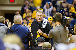 Dec 17, 2016; Morgantown, WV, USA; West Virginia Mountaineers head coach Bob Huggins speaks to the crowd after reaching 800 career wins at WVU Coliseum. Mandatory Credit: Ben Queen-USA TODAY Sports