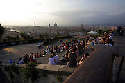 people watching the sun setting over Florence Italy