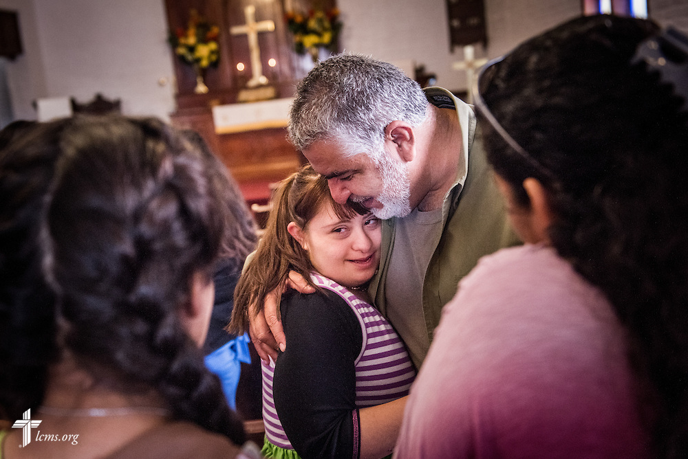 Parishioners Jorge Cavazos and his daughter Gloria hug following worship at El Calvario Lutheran Church on Sunday, April 17, 2016, in Brownsville, Texas. LCMS Communications/Erik M. Lunsford