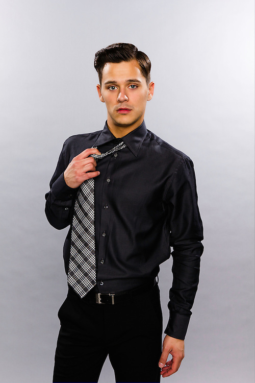 Jeremy Kucharek playing with his tie