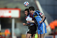 Steve Guinan, left for Cheltenham and Mike Williamson clash<br /> <br /> Photo: Richard Eaton.<br /> <br /> Cheltenham Town v Wycombe Wanderers. Coca Cola League 2. 04/03/2006.