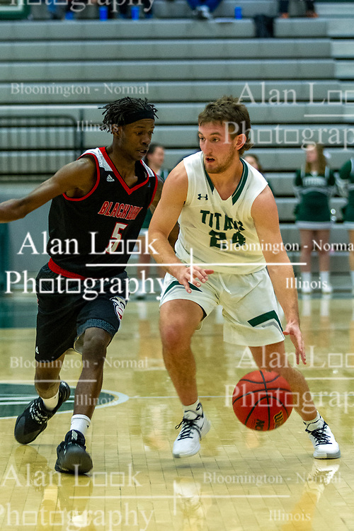BLOOMINGTON, IL - November 12:Chanz Aldridge defends Grant Wolfe  during a college basketball game between the IWU Titans  and the Blackburn Beavers on November 12 2019 at Shirk Center in Bloomington, IL. (Photo by Alan Look)