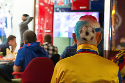 El Cole Columbia, a Columbian football fanatic who has been following the national side for over 30 years watches the Belgium vs Japan match in a bar near Red Square, Moscow.