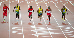 © Licensed to London News Pictures. 05/08/2012. London,UK.Jamaica's Usaine Bolt crosses the finish line in front of USA's Justin Gatlin and Jamaica's Yohan Blake, at the Olympic Stadium, in London, during the London 2012 Olympic Games. Usaine Bolt won the 100m final, breaking the Olympic record .  Photo credit : Bogdan Maran/LNP/BPA