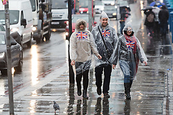 © Licensed to London News Pictures. 17/11/2015. London, UK. Tourists in rain ponchos on Tower Bridge during wet and windy weather today. Photo credit : Vickie Flores/LNP