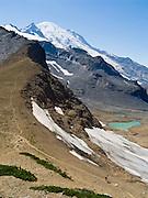 Mount Rainier rises to 14,411 feet elevation. Panhandle Gap on the Wonderland Trail, Mount Rainier National Park, Washington, USA.