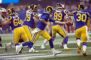 Los Angeles Rams quarterback Jared Goff (16) hands off the ball to Rams running back Todd Gurley II (30) on a third quarter play good for a gain of 16 yards and a first down at the Rams 41 yard line during the NFL Super Bowl 53 football game against the New England Patriots on Sunday, Feb. 3, 2019, in Atlanta. The Patriots defeated the Rams 13-3. (©Paul Anthony Spinelli)