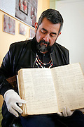 Andrew Galvan points to the entry of his great-great-great-great grandfather in an early baptismal registry for Misión San Francisco de Asís, also known as Mission Dolores, in San Francisco May 19. Listed as number 1552, the entry shows the Christian name given, Faustino. © 2015 Nancy Wiechec