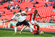 Glenn Walker of Brackley Town (7) holds off George Porter of Bromley FC (18) and Jordan Higgs of Bromley FC (14) during the FA Trophy match between Brackley Town and Bromley at Wembley Stadium, London, England on 20 May 2018. Picture by Stephen Wright.