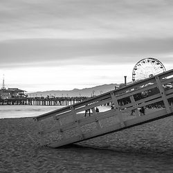 Santa Monica Pier and Lifeguard Tower 17 black and white panorama photo. Santa Monica is a beach city along the Pacific Ocean in Southern California. Panorama photo ratio is 1:3. Copyright ⓒ 2017 Paul Velgos with All Rights Reserved.