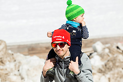 Simon Ammann (SUI) with his child during Ski Flying Hill Team Competition at Day 3 of FIS Ski Jumping World Cup Final 2016, on March 19, 2016 in Planica, Slovenia. Photo by Vid Ponikvar / Sportida