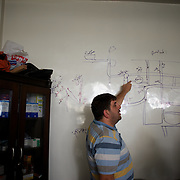 August 14, 2012 - Aleppo, Syria: A Free Syria Army (FSA) commandant points at the positions of government forces in a hand drowned map of Salahedin neighborhood in Aleppo. The Syrian Army have in the past ten days increased their attacks on residential neighborhoods where Free Syria Army rebel fights have their positions in Syria's commercial capital, Aleppo. (Paulo Nunes dos Santos/Polaris)