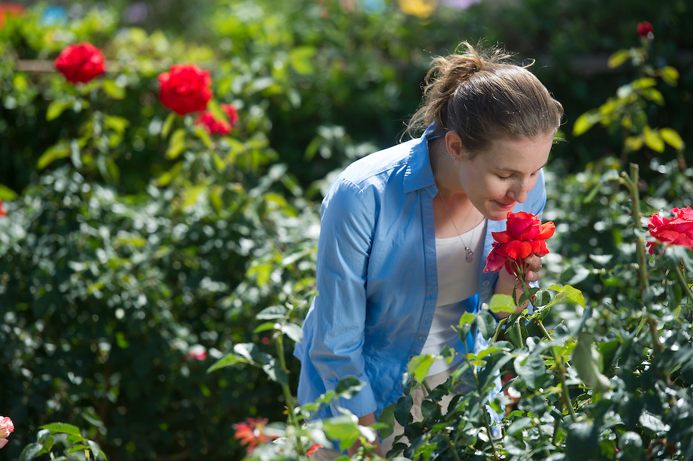 Young Woman Smelling Flower