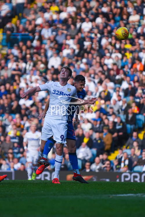 Patrick Bamford of Leeds United (9) heads the ball on during the EFL Sky Bet Championship match between Leeds United and Bolton Wanderers at Elland Road, Leeds, England on 23 February 2019.