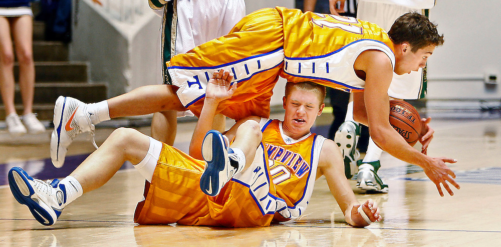 Timpview's Tanner Brockbank, top collides with team mate Lincoln Selk as they both go for a loose ball during play against Snow Canyon in the 2nd round game of the 4A State High School Basketball Championships at the Dee Events Center in Ogden, Utah, Thursday February 28, 2008. Timpview defeated Snow Canyon. August Miller/ Deseret Morning News