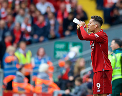 LIVERPOOL, ENGLAND - Saturday, September 22, 2018: Liverpool's Roberto Firmino drinks water from a bottle during the FA Premier League match between Liverpool FC and Southampton FC at Anfield. (Pic by Jon Super/Propaganda)