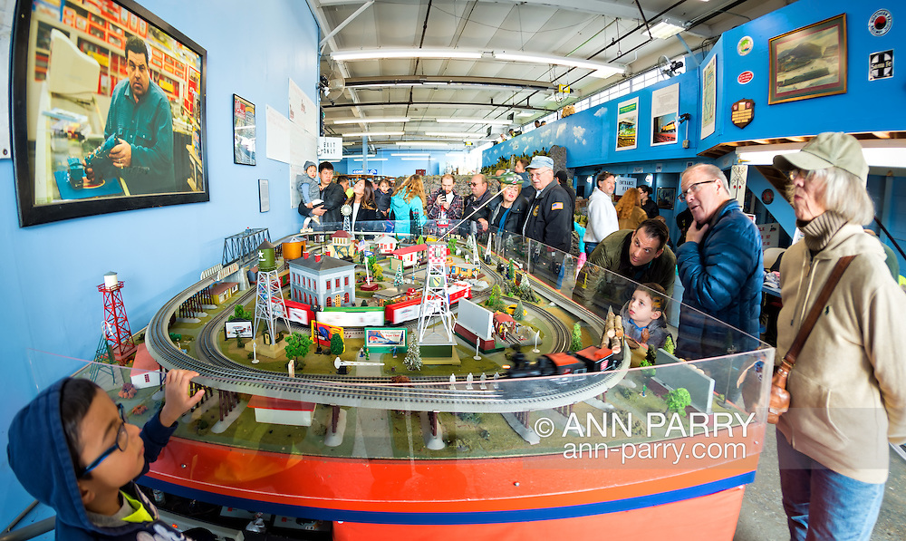 Farmingdale, New York, USA. November 26, 2016.  At TMB Train Masters of Babylon Model Train Club's Open House, visitors look at actual train display - complete with blood stains - seen in 'The Blue Comet' episode of 'The Sopranos'.  Photo above layout is scene with character Bobby Baccalieri at L.I. model train store.
