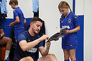 AFC Wimbledon goalkeeper Joe McDonnell (24) signing autographs during the EFL Sky Bet League 1 match between AFC Wimbledon and Rotherham United at the Cherry Red Records Stadium, Kingston, England on 3 August 2019.