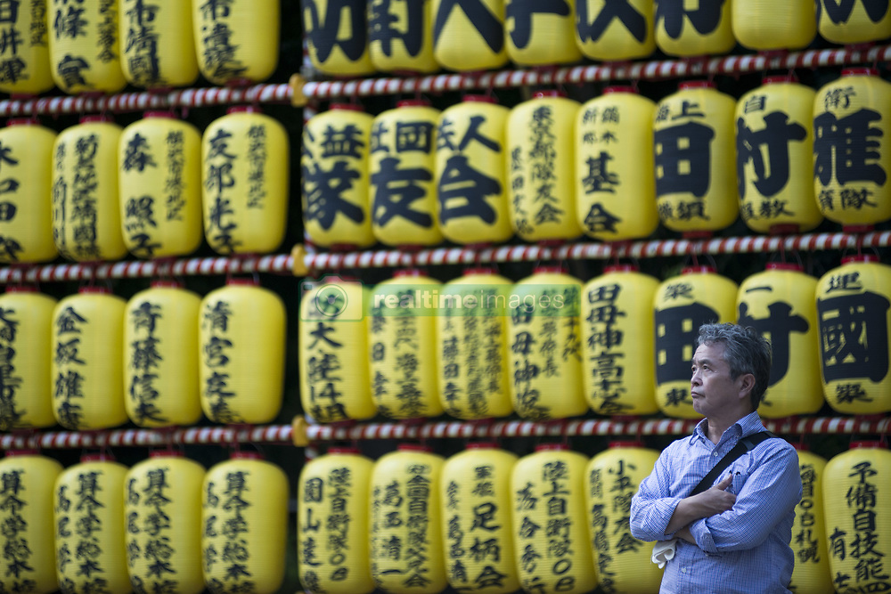 July 13, 2017 - Hiratsuka, Kanagawa, Japan - Visitor enjoy the display of a row of paper lanterns with the names of the shrine deveotees, during the festival of ''Mitama'' or departed souls, at Yasukuni shrine in Tokyo, the shrine decorated with about 30,000 lanterns during the three-day summer festival aiming at comforting souls of dead, especially for the war dead. The festival is after Japan's Buddhist custom to honor and comfort souls of family's ancestors. (Credit Image: © Alessandro Di Ciommo via ZUMA Wire)