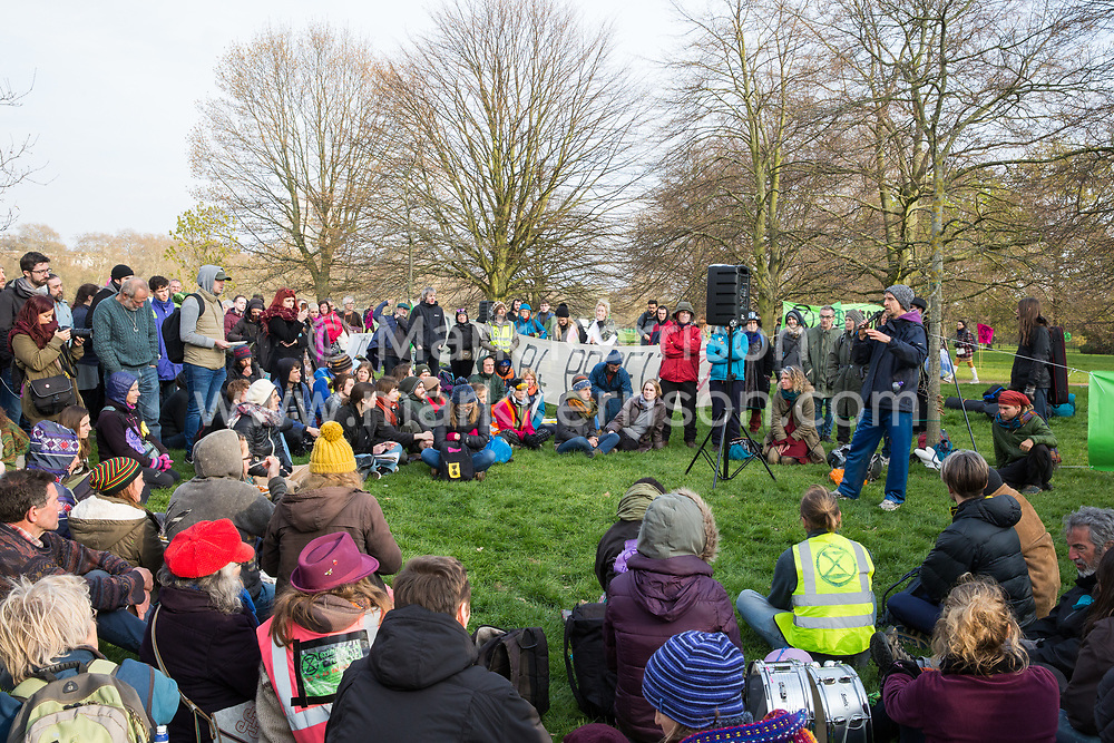 London, UK. 14th April 2019. Climate campaigners from Extinction Rebellion, some of whom had walked from as far away as Land's End on the 'Earth March', receive a briefing in Hyde Park in preparation for 'International Rebellion UK - Shut Down London!' events next week to call on the Government to take urgent action to address climate change.