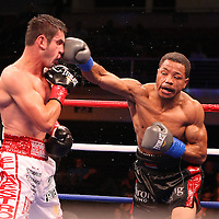 Fighter Mauricio Herrera (left) and Champion Karim Mayfield fight for the  NABO Junior Welterweight Belt during the HBO Triple Explosion fight at the Turning Stone Resort Casino in Verona, NY, on Saturday, Oct 27, 2012. (AP Photo/Alex Menendez)