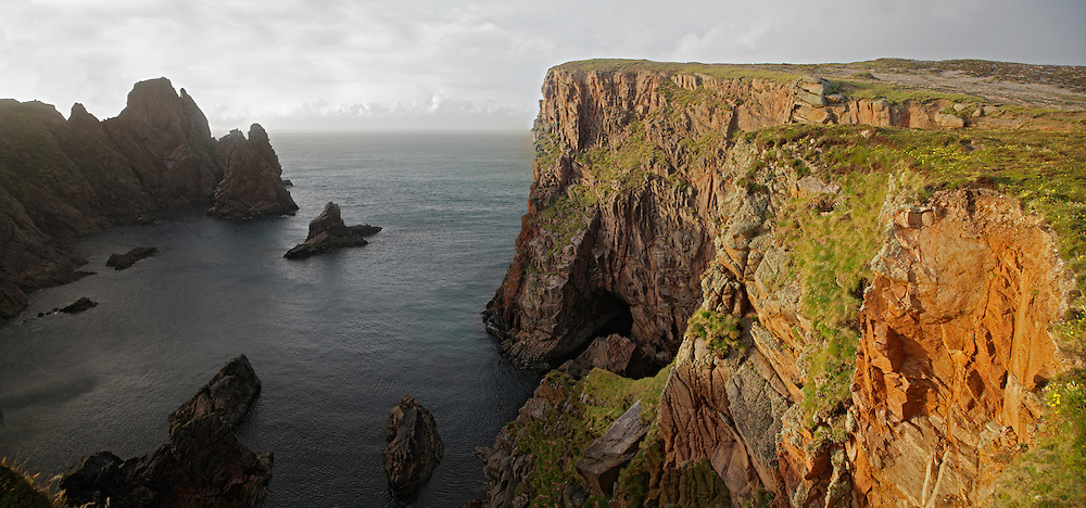 Rain over rugged coast Tory Island Ireland