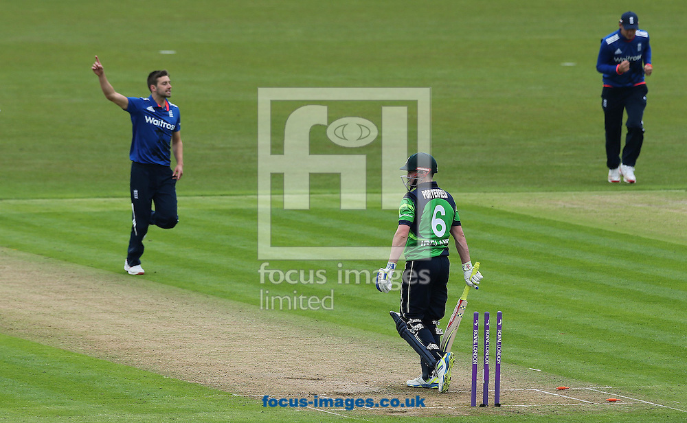 Mark Wood of England celebrates after William Porterfield of Ireland is bowled out during the One Day International match at the Village, Malahide<br /> Picture by Lorraine O'Sullivan/Focus Images Ltd +353 872341584<br /> 08/05/2015