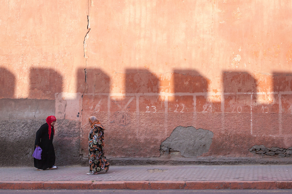 Veiled Arab muslim women on the streets of Marrakech, Morocco, at sunset. Shot in the old mellah (Jewish quarter).<br /> <br /> Licensed by Tandem Stills + Motion (2013). Available here: https://tandemstock.com/assets/73478377