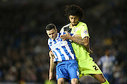 Brighton winger, Jamie Murphy (15) and Huddersfield Town midfielder Phillip Billing (29) tussle during the Sky Bet Championship match between Brighton and Hove Albion and Huddersfield Town at the American Express Community Stadium, Brighton and Hove, England on 23 January 2016.