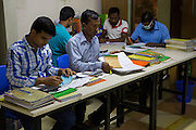 Stock check, accounting and processing orders inside an Epyllion Group garment factory in Bangladesh.