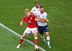 MOSCOW, RUSSIA - Tuesday, June 26, 2018: Denmark's Andreas Cornelius gets a forearm in the face from France's Olivier Giroud during the FIFA World Cup Russia 2018 Group C match between Denmark and France at the Luzhniki Stadium. (Pic by David Rawcliffe/Propaganda)