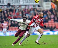 Stoke City/Sunderland Premiership 05.02.11<br />Photo: Tim Parker Fotosports International<br />John Carew Stoke & John Mensah Sunderland