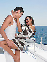 Young couple embracing on yacht side view